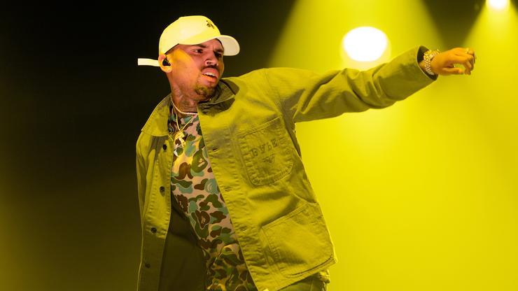 Chris Brown Flexes His Shiny Gold Nike Sports Car - ImPlurnt